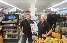Spar Express Yamba owners Angus Suttor and Philip Moore with their award for 2012 Eastern Region Spar Express store of the year Photo Adam Hourigan / The Daily Examiner
