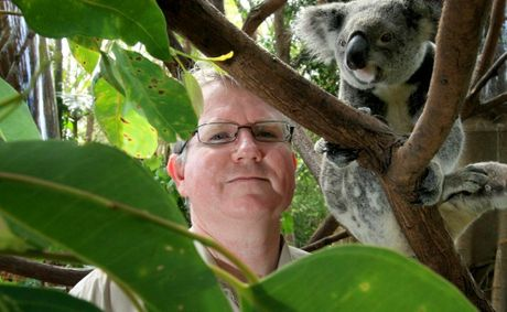 Currumbin Wildlife Sanctuary head vet Michael Pyne, with koala Baby, knows first-hand the benefits of working in the animal care industry.