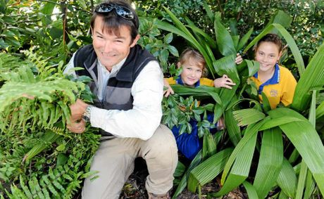GREEN THUMBS: Oakwood State School P&C; president Dean Logan, students Mackenzie Logan and Jodie Mears rip out noxious weeds to replace them with native plants thanks to a grant from Landcare Australia.