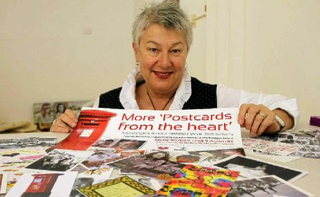 CARD ART: Lismore City Council social planner Christine Minkov with some of the postcards being exhibited.