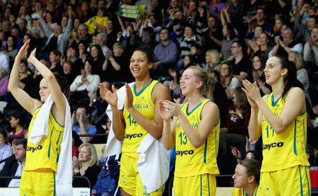 Elizabeth Cambage of the Opals celebrates with team-mates after the third match between the Australian Opals and Brazil at the State Basketball Centre on June 28, 2012 in Melbourne, Australia.