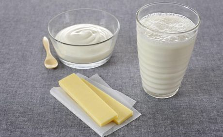 Full-fat dairy consumers could have reason to smile, with research finding no evidence they are linked with obesity.
