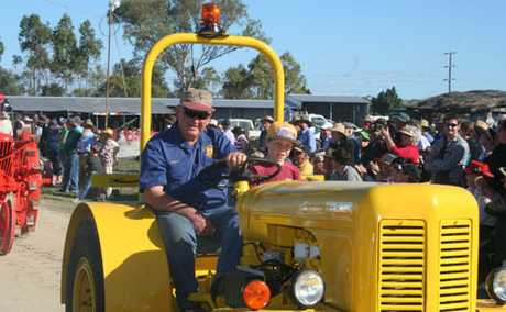 RARE: Merv Hill drives his David Brown tractor into the Heritage Rally during the procession.
