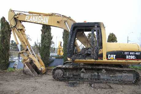 GUTTED: This $120,000 digger was burnt out by arsonists; one of two in the city in recent weeks.