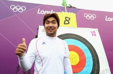 South Korean archer Im Dong Hyun celebrates smashing a world record.