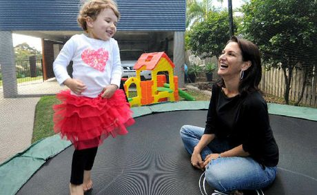 Aislin Carlyon plays with mum Karla Steen, who has a new focus on good nutrition and healthy product choices after being diagnosed with a form of cancer called Ductal Carcinoma in Situ.
