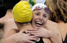 The Australian team celebrate winning the women&#39;s 400 metre freestyle relay final.