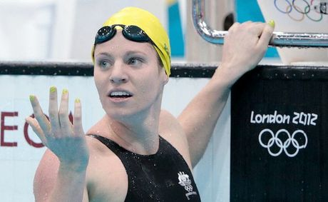 Emily Seebohm has come within a whisker of a world record in the heats of the 100m backstroke.