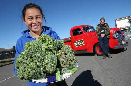 GREEN FINGERS: Merivale School's Shackera Waaka, 11, with a plate of broccoli grown in the school's garden and Tony Andrew of McCain.