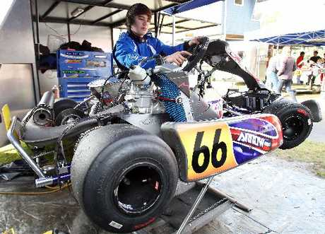 RISING STAR: Mount Maunganui College student Josh Adlam prepares his kart before racing.