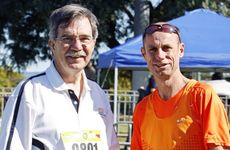 Robert Walker from the Ipswich Hospital Foundation with Steve Moneghetti at the Park2Park event. Photo: Claudia Baxter / The Queensland Times
