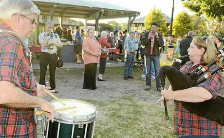 Alan Somerville and Jenny Henry play the bagpipes during the jail thank you barbecue at Jacaranda Park on Sunday.