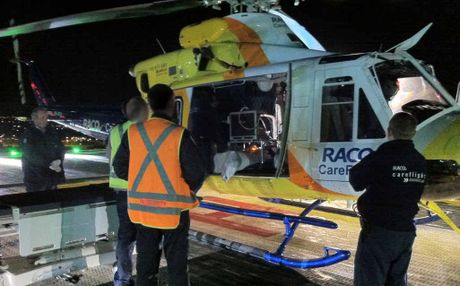 RACQ CareFlight transports a man with gunshot wounds to the Princess Alexandra Hospital in Brisbane on Friday night.