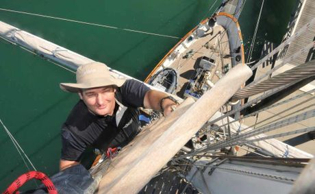 Young Endeavour watch leader Josh Bignell has a unique view of Mackay Marina as he climbs the tall ship's 35-metre (105 ft) mainmast.