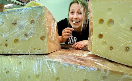 Testing out a morsel taken from a 101kg block of emmental Swiss cheese is Georgina Mockel of Wendland Olives.