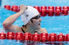 Shiwen Ye of China celebrates after she set a world record to win the Final of the Women's 400m Individual Medley on Day One of the London 2012 Olympic Games at the Aquatics Centre on July 28, 2012 in London, England.
