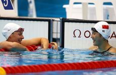 Alicia Coutts (left) has claimed silver behind China&#39;s Shiwen Ye in the women&#39;s 200 metre individual medley.