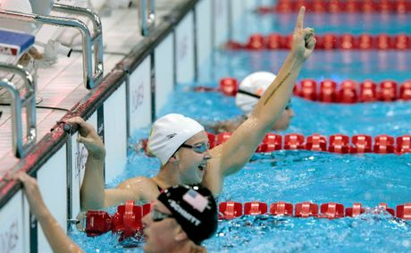 Melanie Schlanger of Australia celebrates after she swam the last leg of the relay to win the Final of the Women's 4x100m Freestyle Relay on Day 1 of the London 2012 Olympic Games at the Aquatics Centre on July 28, 2012 in London, England.