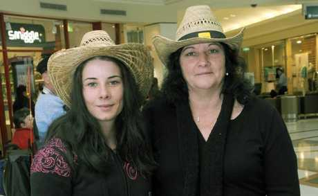 Tara Jones (left) and Trisha Finn enjoy a free concert to promote the upcoming Gympie Country Music Muster.