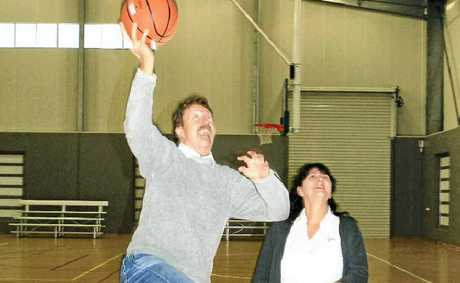 ON TARGET: Basketball Association stalwarts Rob and Dawn Ashdown jump for joy at the news that the Ewingsdale Rd courts are ready to play on.
