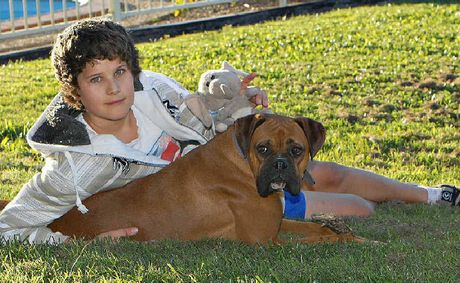 Andrew Tomlin and his dog Fudge. The Year 9 student required major surgery in Brisbane, which was a success.