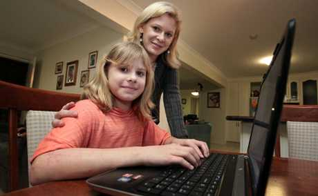 INTERNET SAFETY: Hayley Pearl, 10 uses the internet as her mum Michelle watches on.