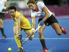 Teneal Attard tussles with Germany's Christina Schutze during the game that Australia won 3-1.