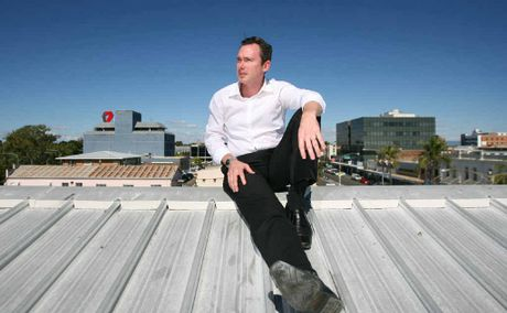 Andrew Beaumont checks out the view from the roof of the Sullivan Nicholaides building where work on the new Empire development will commence later in the year.
