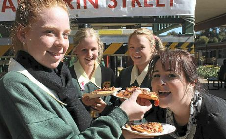 Students at Assumption College hoed into pizza and soft drinks at a fundraiser for Montrose Access. Deanna Kelly fed teacher Kristy Liesegang a piece while Sophie Grayson and Mikayla Rolfe had their own.