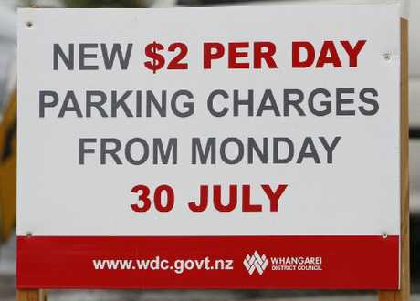 Signs go up indicating parking charges at the Whangarei Town Basin carpark, but the charges are on hold. Photo / John Stone