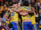 Chris Sandow (R) of the Eels celebrates with team mates during the round 21 NRL match between the Brisbane Broncos and the Parramatta Eels at Suncorp Stadium on July 30, 2012 in Brisbane, Australia.