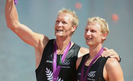 Eric Murray and Hamish Bond celebrate winning gold. 