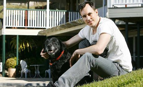 Jersey Boys actor Glaston Toft relaxes with dog Ruby at his parents' Fernvale home during the Brisbane leg of the musical's tour.