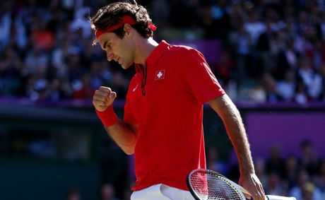 Roger Federer of Switzerland celebrates a point against Juan Martin Del Potro of Argentina in the Semifinal of Men's Singles Tennis on Day 7 of the London 2012 Olympic Games at Wimbledon on August 3, 2012 in London, England. Federer defeated Del Potro 4-6, 7-6, 19-17.