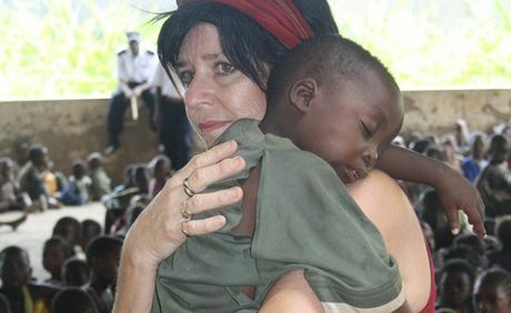 Bundaberg&#39;s Cathy Booth comforts a child at the Umoja Orphanage in Kenya.