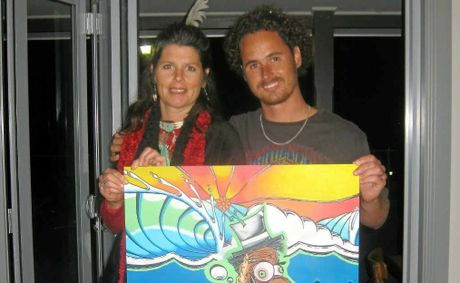Sarah McCafferty who threw down her unique brand of singer-songwriting on the night and the man of the hour himself, Mr James Waghorn. The pair are holding up one of Jimmy's canvas works.