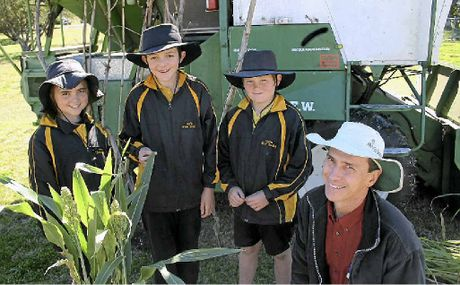OUTDOOR LESSON: Pilton State School students Michaela Groombridge, Thomas Nicol and Simeon Butler with DAFF senior plant breeder (sorghum) Alan Cruickshank.