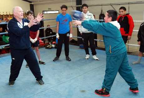 RING CRAFT: Billy Graham steps into the ring with Codie Irwin, 10, and some of the other young candidates from the Flaxmere Boxing Academy.