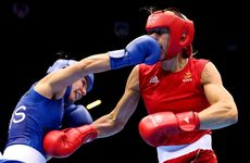 Anna Laurell of Sweden (right) in action with Naomi-Lee Fischer-Rasmussen of Australia during the Women's Middle (69-75kg) Boxing on Day 9 of the London 2012 Olympic Games at ExCeL on August 5, 2012 in London, England.