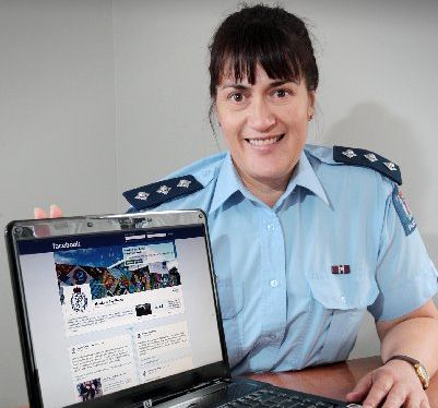 Tania Kura, police inspector, checks the policing Facebook site.