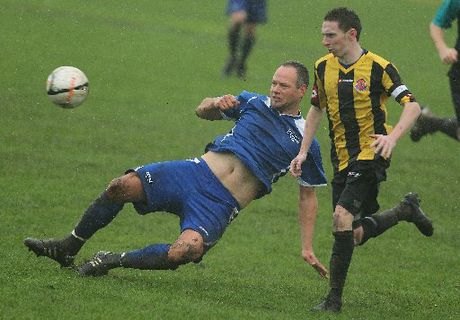 Tauranga City United's Tom Livesey loses his footing in the wet conditions at Links Ave. Photo / John Borren