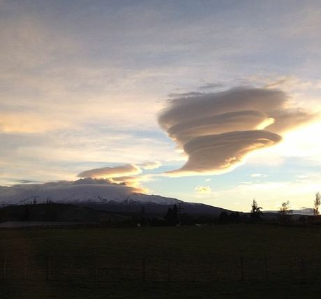 A cloud hangs above the Mt Tongariro after the mountain erupted overnight.