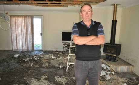 Michael Banks came home from a week away to this. His roof collapsed and his furniture covered in debris and water after a copper pipe burst in hie ceiling.