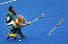 Matthew Butturini of Australia is fouled by Shafqat Easool of Pakistan during the men's hockey match between Australia and Pakistan on Day 11 of the London 2012 Olympic Games at Riverbank Arena Hockey Centre.
