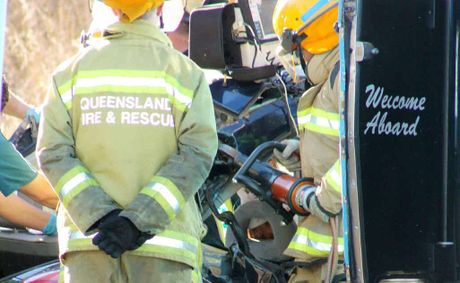 Queensland Fire and Rescue crews work to free the trapped female student driver.