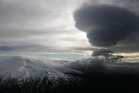 GREY SKIES: Cloud shrouds the central North Island mountains after Mt Tongariro erupted. PHOTO/SNPA, ROB TUCKER