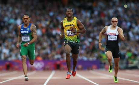 Yohan Blake (centre) has set up another showdown with compatriot Usain Bolt in the 200 metre final.