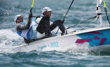 Mathew Belcher and Malcolm Page's race for gold has been delayed by light winds.