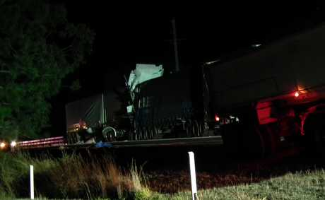 A man has died after a truck crash on the Bruce Highway near Maryborough involving two semi-trailers.