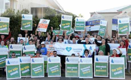 Gympie teachers rally at the office of MP David Gibson yesterday.